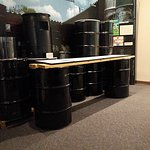 Museum Exhibit - Note height of tablets above oil drums.