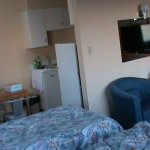 Double bed and twin bed in living room adjacent to kitchen/dining and still plenty of chairs to