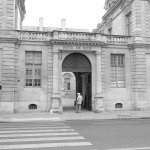 An elderley Paris man pauses at the entrance to Hotel de Sully. B&W conversion in camera Fuji X-