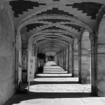 A view of the fabulous arcades that surround Place des Vosges. B&W conversion in camera Fuji X-T