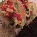 Coconut shrimp tacos with cilantro rice and black beans