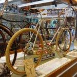 The single piece of wood wheel is stunning - metal spokes.