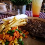 The delicious tenderloin steak and fruit punch from Suis Butcher Bandung, Indonesia.