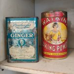 Old containers of baking powder and ginger