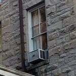 Close up of female ghost in window.