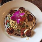 Pan seared scallops with creamy  farro, local sweet corn, spinach and Roosevelt  grown tomatoes