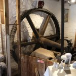 Inside the restaurant showing the drive gears that are powered by the waterwheel on the outside