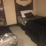 Uneven bed - Foot end of bed is raised higher than head area. Mattress so used it curves in midd