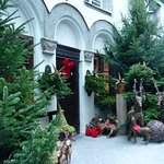 A large courtyard filled with reindeer and Christmas trees