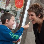 Young boy lets his mum try his icecream outside Giulianotti's