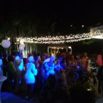 Poolside wedding reception, enjoying the party