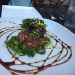 Tuna Poke starter with soy/sesame and seaweed salad & microgreens.