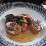 Country chicken with Parma ham, tapenade, polenta and tomato sauce