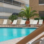 Swim or Sunbathe at the Outdoor Pool