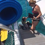 One of Sebago's mate helping my husband to get back on the boat after snorkeling