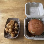 My Drunken Goat burger and side of Truffle Tater Tots