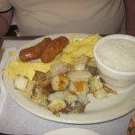 Scrambled Eggs with Breakfast Sausage, Hash Brown Potatoes & Grits