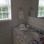 Beautiful sink & subway tile in bathroom (2 big windows as well).