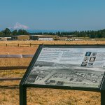 Info sign overlooking Pearson Field with Mt. Hood in the background