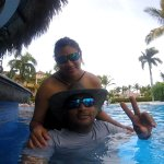 Me and wife at pool bar.