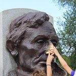Rubbing Lincoln's nose for luck.