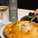 Our scratch-made chicken pot pie goes great with a glass of chardonnay