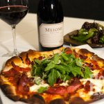 A pinot noir works perfectly with our mascarpone and Italian speck pizza.