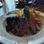 wagu beef steak with crisp fries and asparagus