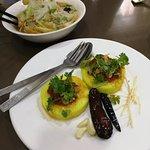 'Hta min chin' -- sticky yellow rice with tomato salsa/sauce, coriander, raw garlic, and onion r