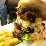 Moto burger :: Beef patty topped with a potato rosti, cheese sauce, mushrooms & bacon