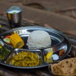 Unlimited food (Rice + Dal + Chapati + 2 vegetable dishes + Salad + Papad + Dessert + Chaas)