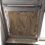 """Fix"" for ""security"" door that faces parking lot hidden from street"