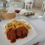 Greek meatballs in tomato sauce with chips and the Dolmades.