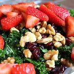 Supersalad: Strawberries, walnuts & dried cranberries on kale, marinated with our sesame poppyse