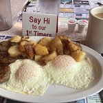 """My breakfast with our sign """"Say Hi to our 1st Timers"""""""