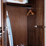 Closet equipped with locking room safe, iron and board