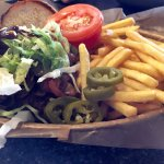hamburger with toppings, and crispy fries