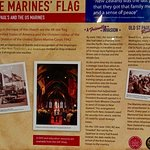 Sign Explaining the Presence of the USMC Flag in the Church
