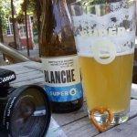 Enjoying cold beer under the dark tree shade