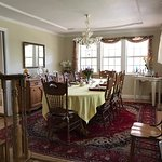 Guests in the main building at the Blackberry Inn enjoy breakfast family style around a large ta