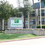 Exit at O'Connor and turn in our parking Lot At Holiday Inn Las Colinas