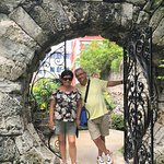 my parents in front of a lovely iron/stone gate