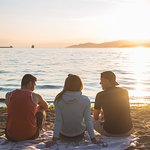 Friends enjoying the sunset at Vancouver's English Bay