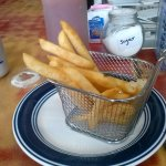 Fries in a fryer basket, delicious