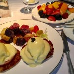 Eggs benedict and fruit plate