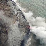 Lava spilling into the sea