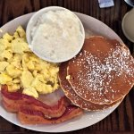 Trolley Special - 2 eggs served with grits, 2 pancakes, choice of ham, bacon or sausage.