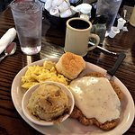 Country Breakfast - 2 eggs with chicken fried steak & country gravy, choice of grits or potatoes