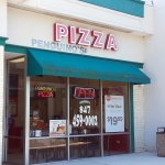 front of & entrance to Penguino's Pizza