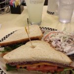Roast beef and cheddar sandwich with coleslaw and lemonade